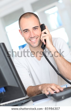 Smiling man answering the phone