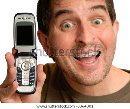 Smiling man holding up a cell phone.