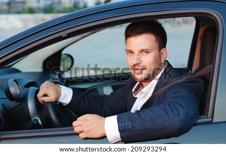 smiling man in the car, happy driver