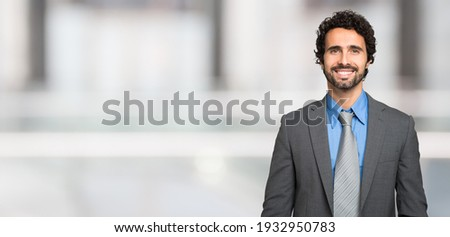 Smiling man, large bright background, wide banner image Stockfoto ©
