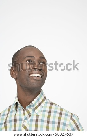 Smiling Man looking up and over shoulder