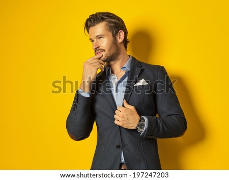 Smiling man on yellow background