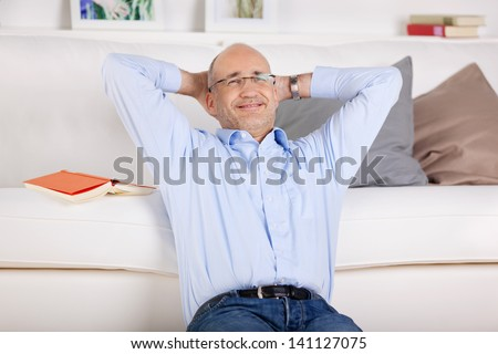 Smiling man relaxing and sitting in the living room