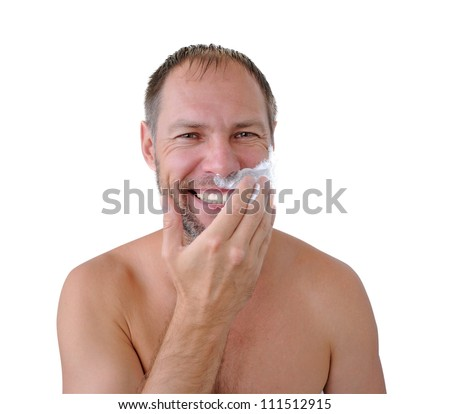 Smiling man shaving with foam on the white background