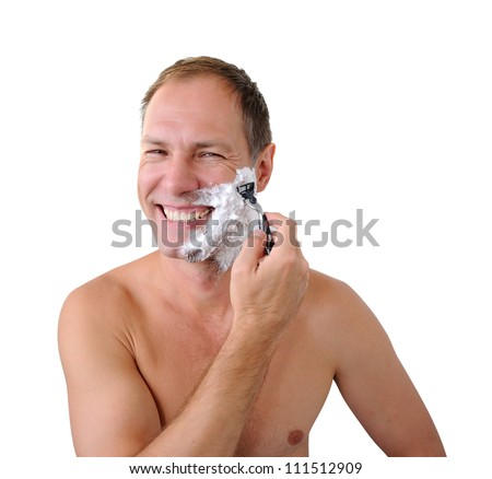 Smiling man shaving with razor and foam on the white background