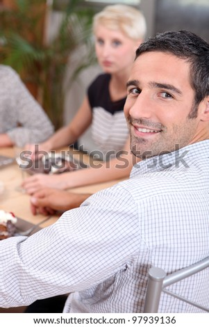 Smiling man sitting at a table