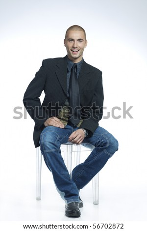 smiling man sitting in a chair