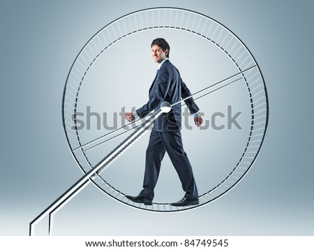 smiling man walking in hamster wheel