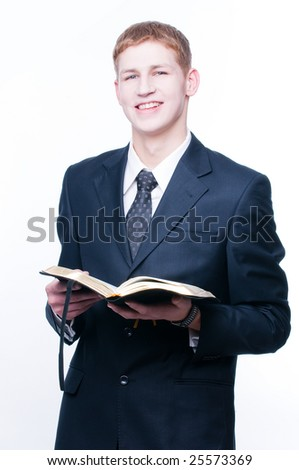 Smiling man with Bible, isolated on white background
