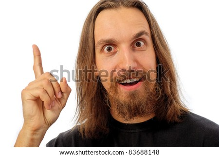 smiling man with finger pointing, looking at viewer straight