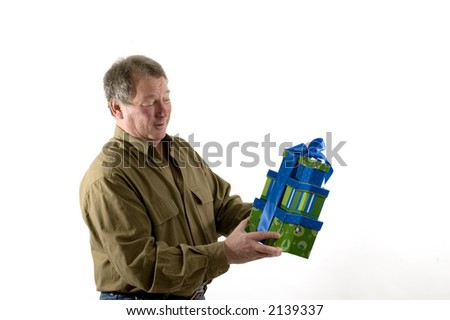 smiling man with gifts wrapped in boxes