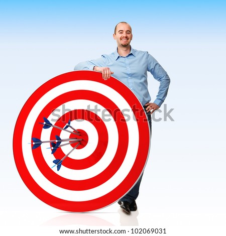 smiling man with target and arrows