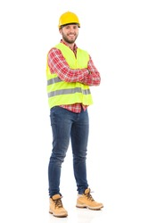 Smiling manual worker. Smiling construction worker in yellow helmet and lime waistcoat. Full length studio shot isolated on white.
