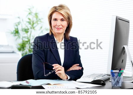 Smiling mature business woman. In a modern office.