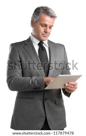 Smiling mature businessman working on digital tablet isolated on white background