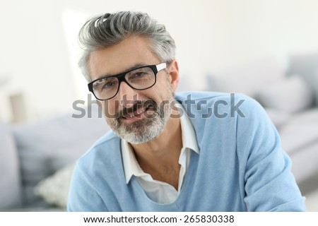 Smiling mature man with grey hair wearing eyeglasses - Shutterstock ID 265830338