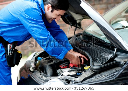 Smiling mechanic doing a maintenance check #331269365