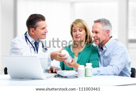 Smiling medical doctor and patient. Health care.