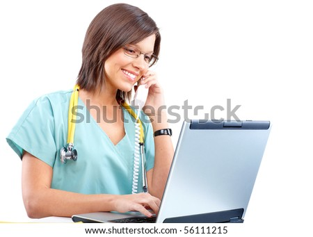 Smiling medical doctor with telephone and laptop