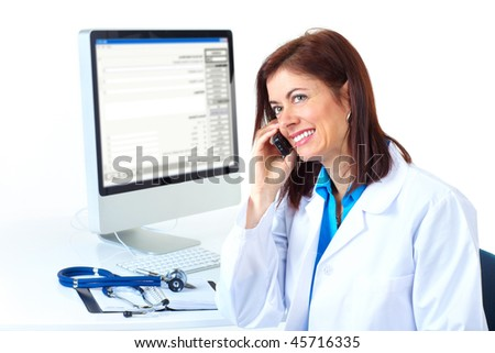 Smiling medical doctor woman with computer and telephone. Isolated over white background