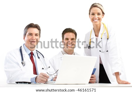 Smiling medical doctors with stethoscopes and laptop. Isolated over white background