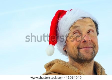 Smiling men with beard in santa's hat