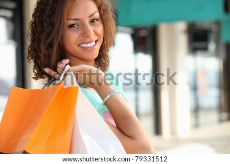 Smiling Metis woman carrying shopping bags