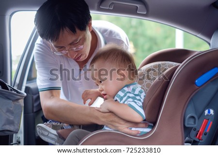 6 Months Old Baby Boy Sitting In Child Car Seat 410947570 Smiling Middle Age Asian Father Helps His Cute Little 1 Year Toddler