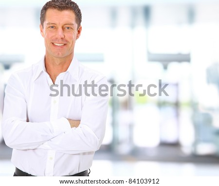 Smiling middle aged business man