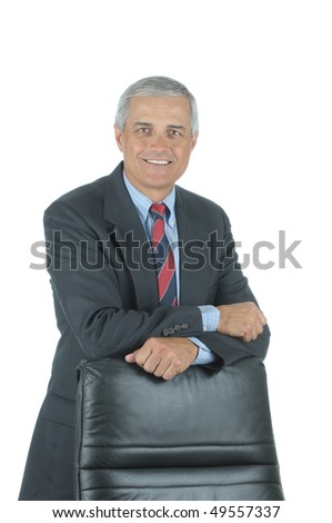 Smiling Middle Aged Businessman leaning on chair back isolated on white