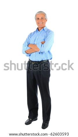 Smiling middle aged businessman standing with his arms folded. Business man is in full  length over a white background.