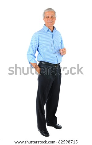 Smiling middle aged businessman standing with one hand in his pocket and the other holding his eye glasses. Business man is in full  length over a white background.
