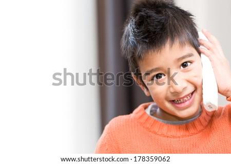 smiling mischievous little boy...