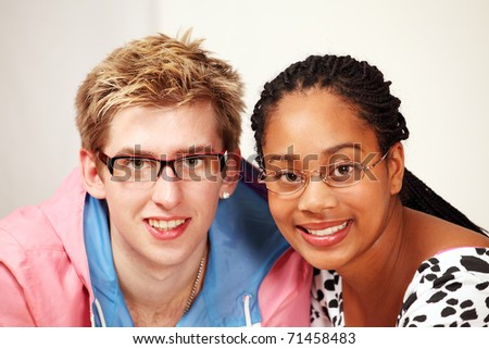 Smiling mixed race couple with glasses