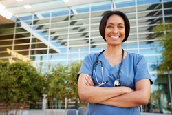 Smiling mixed race female healthcare worker outside hospital