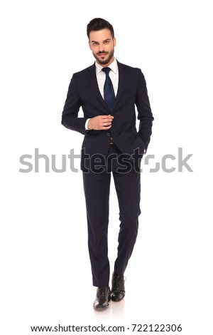 Shutterstock smiling modern business man with one hand in pocket and one on the coat's button looks at the camera, on white background