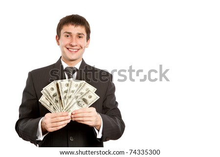 Smiling modern businessman holding money in his hand isolated on white