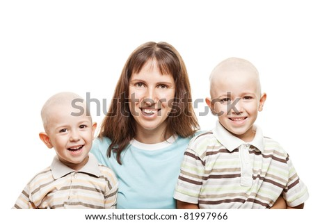 Smiling mother and little sons - family happiness