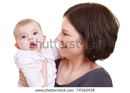 Smiling mother looking at surprised baby girl