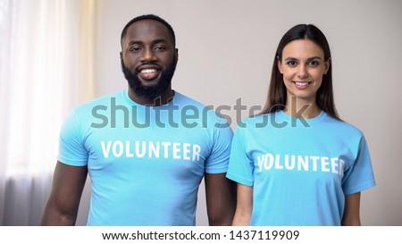 Smiling multiethnic volunteers standing straight in rehabilitation center, help