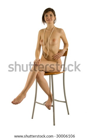 Smiling Naked Girl With Pearl Beads Sitting On A Chair Isolated