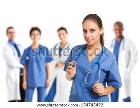 Smiling nurse in front of her medical team