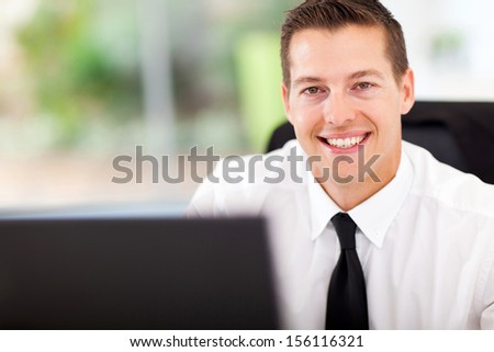 smiling office worker looking at the camera - stock photo
