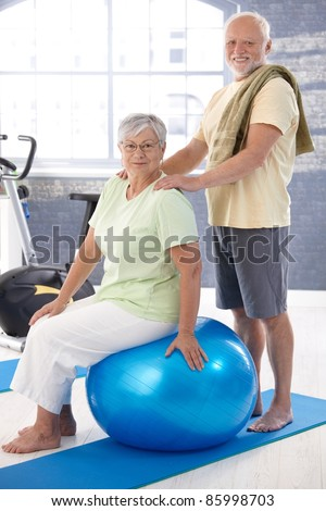 ... relaxing after workout, man giving massage to woman.? - stock photo