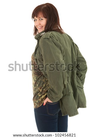 smiling overweight teenage girl  in military jacket, white background
