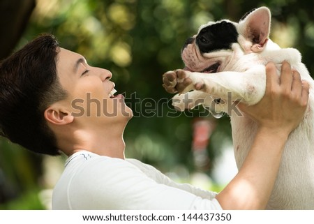 Smiling Owner Holding His Friendly Pet With Affection
