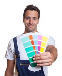 Smiling painter showing colors