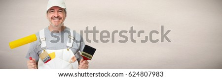 Smiling painter worker man