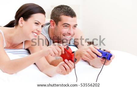 Smiling parent playing video games  at home