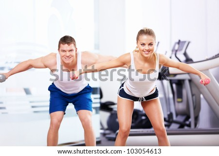 Smiling people in the fitness club